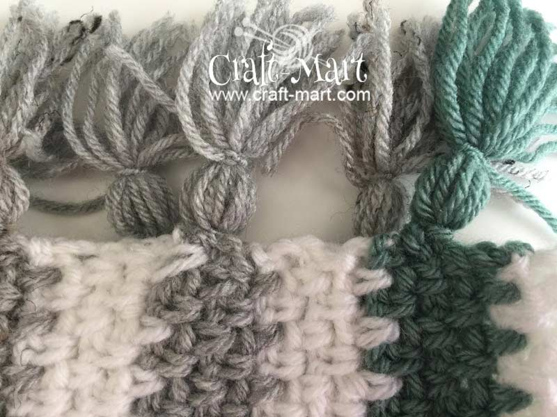 easy to crochet moss stitch woodlands blanket with DIY tassels by craft-mart