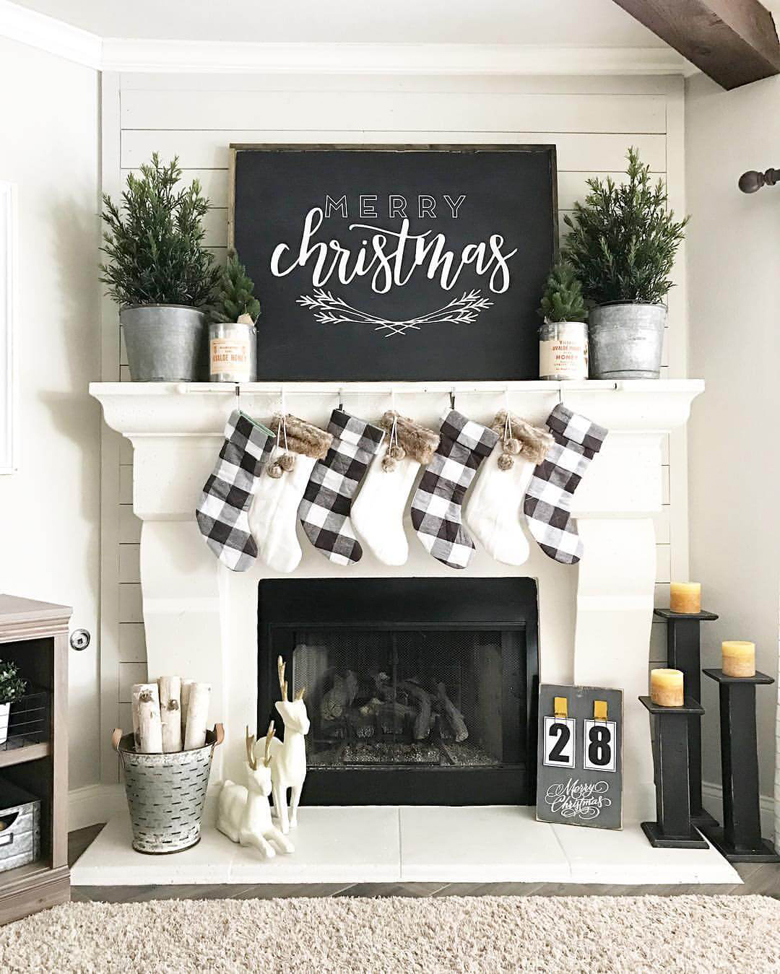 Black and White Modern Farmhouse Mantel - Using Stockings as rustic christmas ornaments is always a good idea for rustic Christmas decor