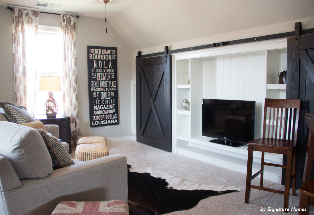 Black barn door in farmhouse family room