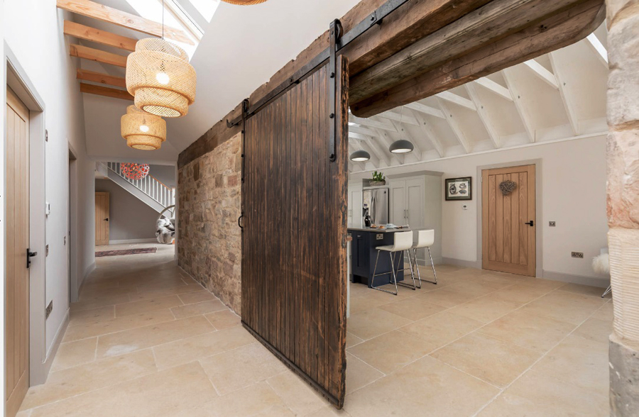 Rustic reclaimed wood door in barn-to-house conversion craft-mart