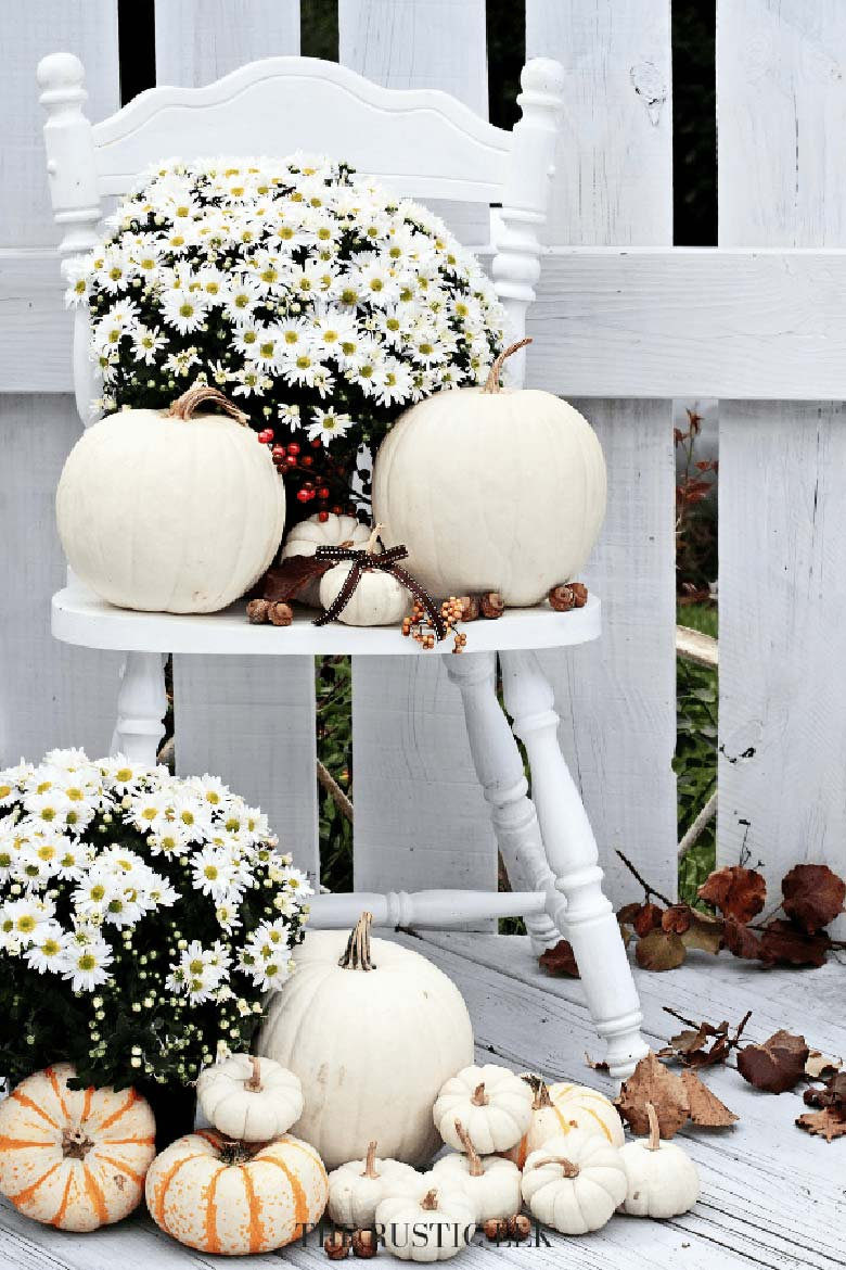small front porch decorating ideas - white pumpkins in a variety of sizes and a few buckets of white mums will complete this easy DIY fall porch decor project. #frontporchideas #outdoorfalldecoratingideas #smallfrontporchdecoratingideas
