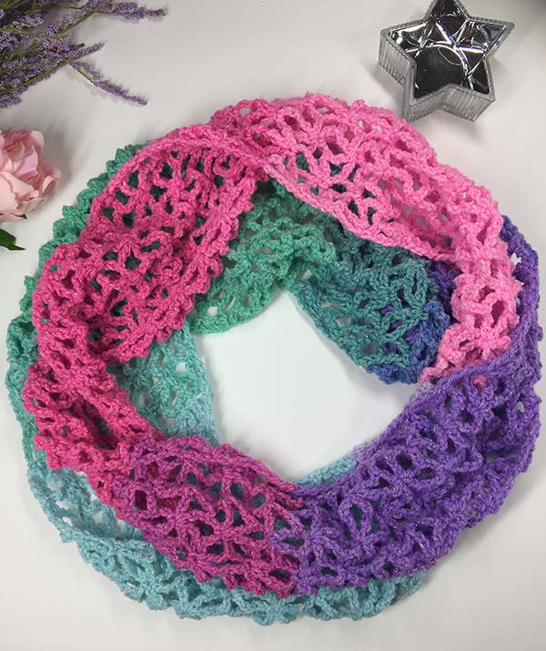 Learn to crochet lacy spring-time infinity scarf with our FREE PATTERN